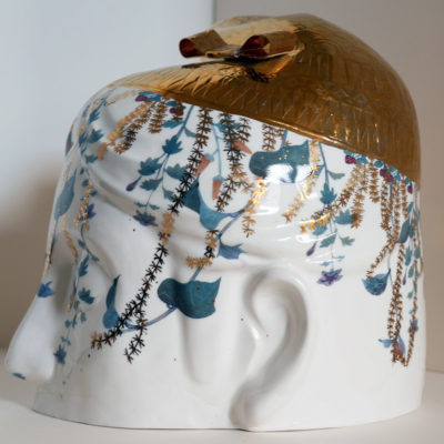 Gold Hat Head, Porcelain sculpture, side view, 11 x 9 inches
